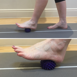 Rolling a ball on the sole of the foot to release tension in the plantar fascia