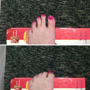 Demonstration of toe curl exercise - squeeze toes over the top of a big book.